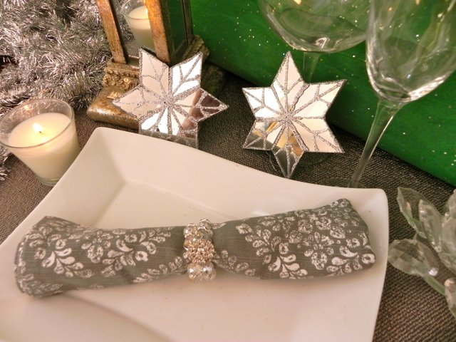 Use pretty costume jewelry to wrap around your napkin and place ornaments around the table!